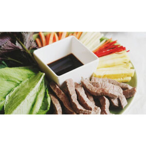 Grilled beef rolled in cabbage